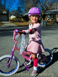 Sweet Pea shows off her new bike.